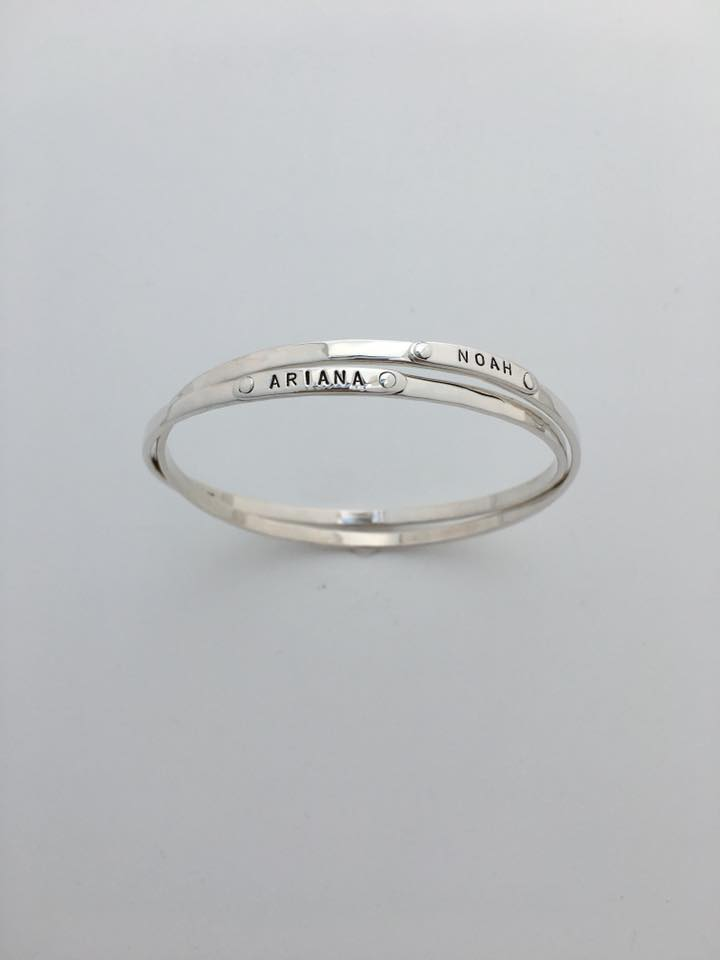 Double silver bangle bracelets with names Ariana and Noah