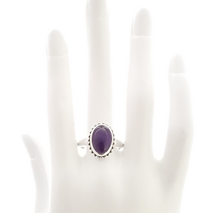 Sterling silver and amethyst ring on mannequin hand