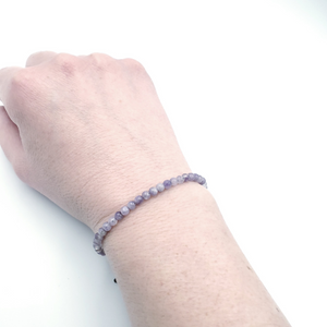 Light purple beaded bracelet shown on wrist