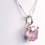 Oval pink faceted silver prong set necklace