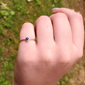 Petite silver and lapis ring on hand