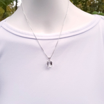 Sterling silver white topaz necklace shown on mannequin