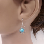 Silver circle and turquoise bead earring on mannequin