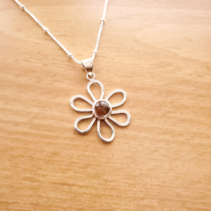 Open silver daisy necklace with amber in center