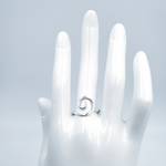 Spiral silver ring on mannequin hand