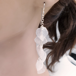 Many light pink leaves cascading to form earrings