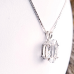 Prong set white topaz pendant side view