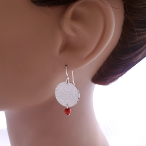 Hammered sterling silver round earrings with coral accents