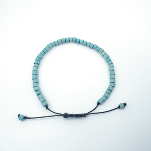 Turquoise colored wooden beaded bracelet