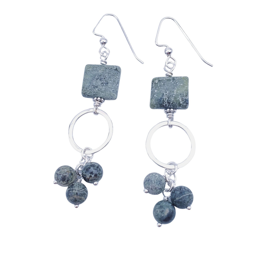 square green bead with silver open circle below and 3 round green bead dangling below earrings