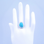 turquoise ring with textured border shown on mannequin hand
