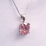 Oval pink faceted cubic zirconia set in sterling silver prong setting