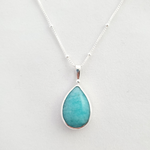 Teardrop robin's egg blue amazonite stone with silver ball at top beneath bail