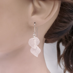 Two light pink leaves dangle earrings