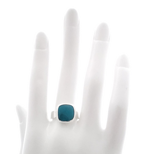 Square bezel set turquoise silver square shank ring shown on mannequin hand