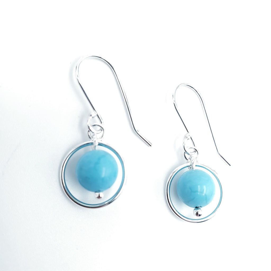 Round turquoise bead with silver circle earrings