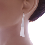 Long textured earring shown on mannequin