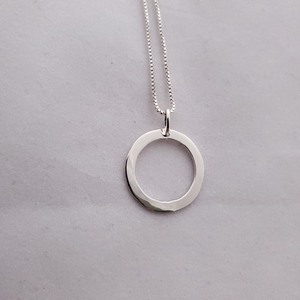 Back of pendant - plain slightly hammered silver circle necklace