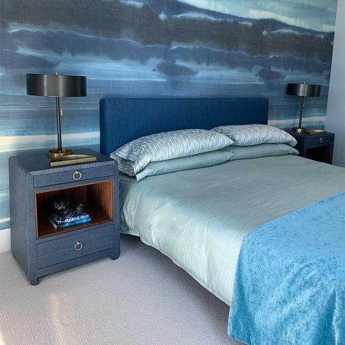 Bed with custom bedding, elegant night stands and bedroom lamps