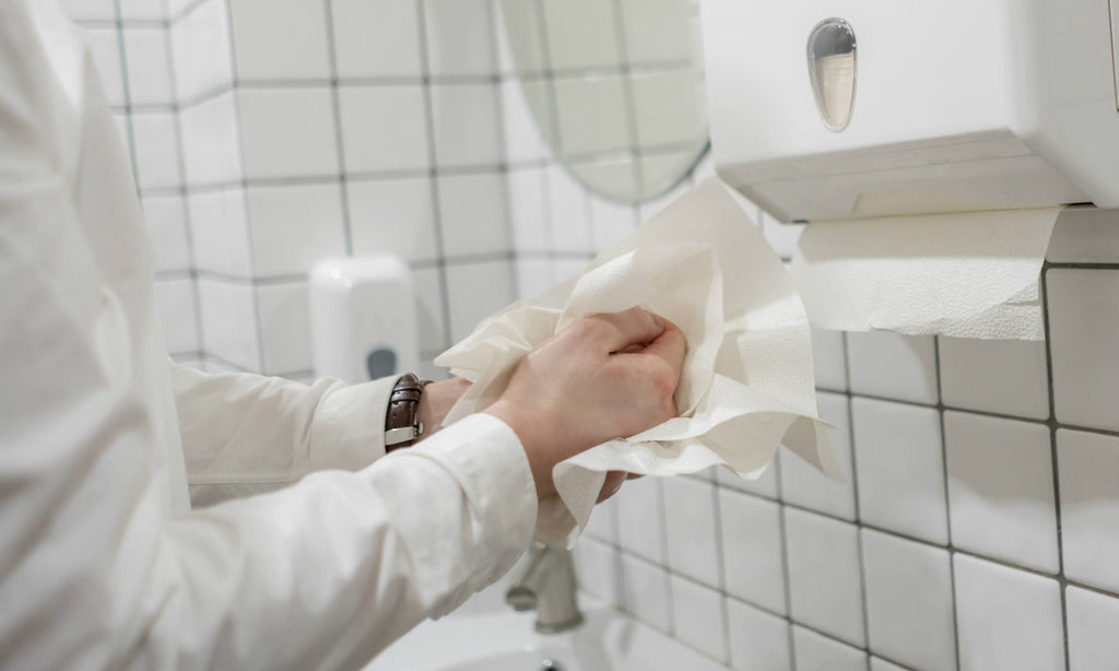 wiping hands on paper hand towel