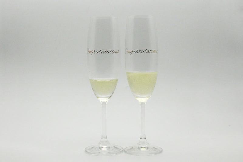 set of champagne glasses with congratulations in metallic gold text