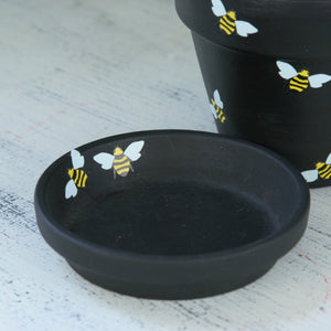 Black flower pot with bumble bees