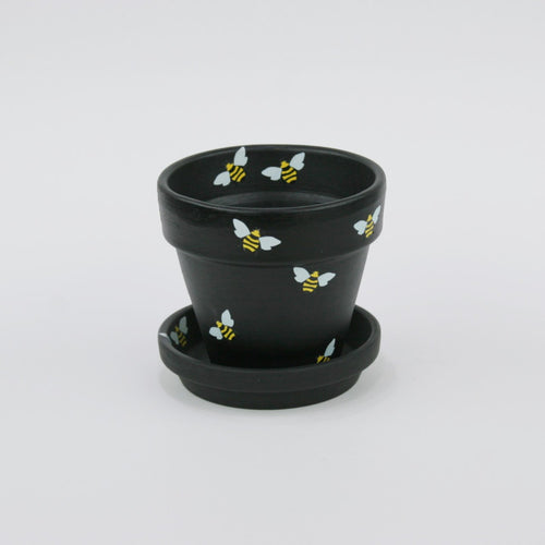 Indoor flower pot with bumble bees