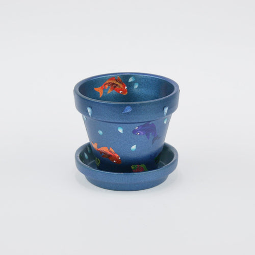 Indoor flower pot with fish