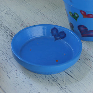 Blue flower pot with hearts