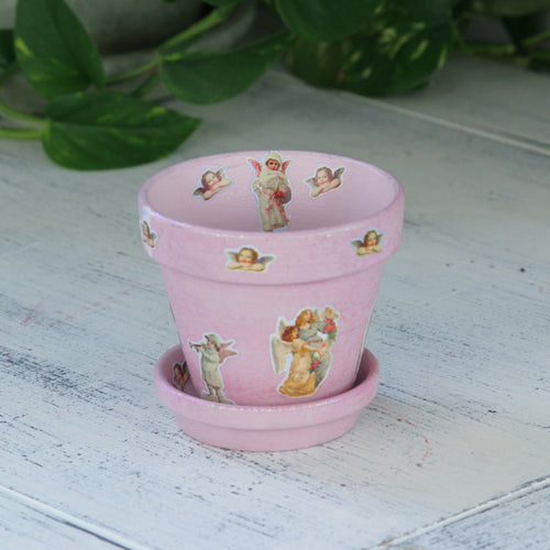 Pink flower pot with angels