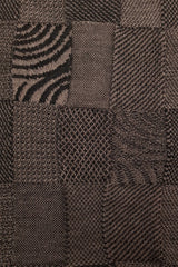 Close up of the pattern of the Cinamon Black Royal Alpaca and Merino Textured Wrap