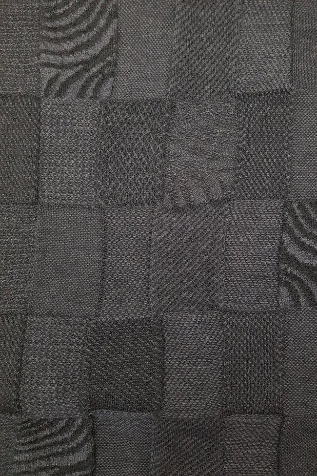 Closeup of the pattern of the Dark Grey Charcoal Royal Alpaca and Merino Textured Wrap