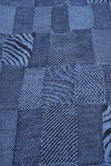 Close up of the pattern of the Denim Black Royal Alpaca and Merino Textured Wrap