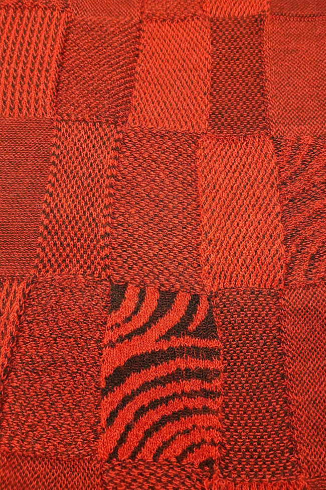 Close up of the pattern of the Red Black Royal Alpaca and Merino Textured Wrap