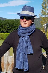 Roy wearing the Denim Black Royal Alpaca and Merino Textured Wrap