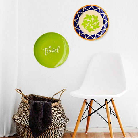 Green And Blue Wall Plates by White Chair