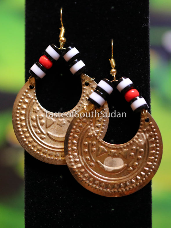Authentic African Beaded Earrings Red, white and black glass beads and gold moon charm.  Hand made by women in South Sudan using traditional beading techniques passed down generations.  Sudanese hilal earrings.