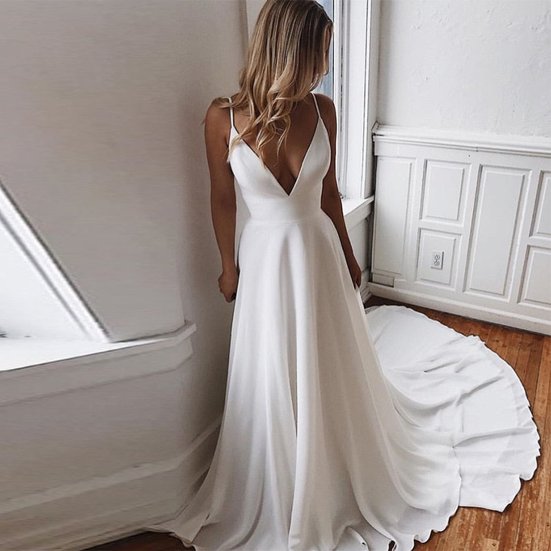 Deep V-Neck Appliques Spaghetti Straps Backless Bridal Gown