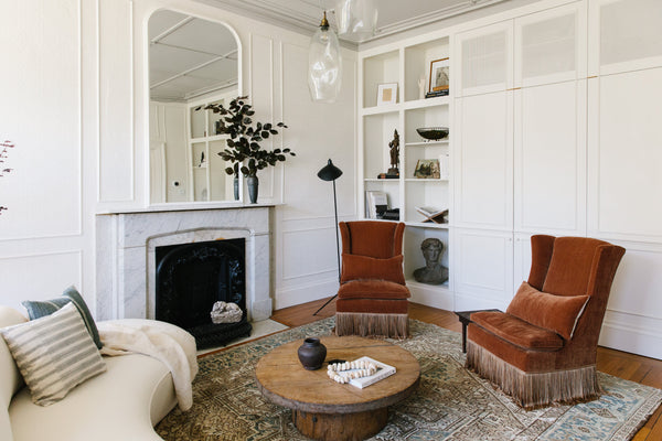 living room with curved sofa
