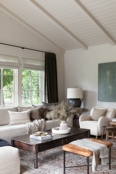 warm modern living room by Amber Interiors with vintage rug