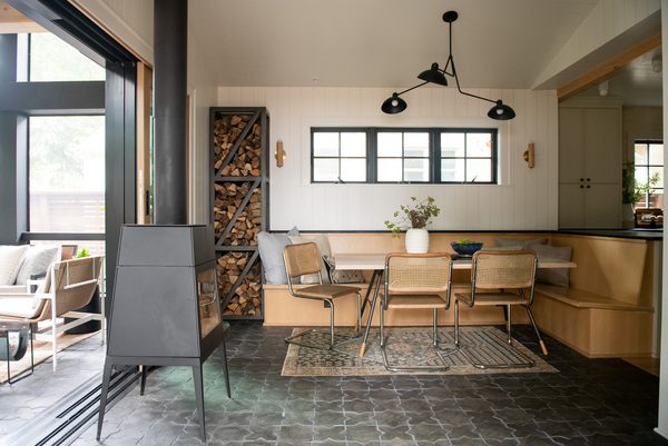 organic modern dining space with vintage rug