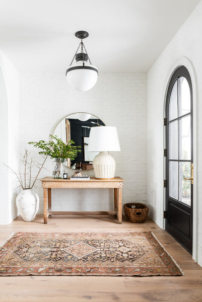 entry with vintage rug