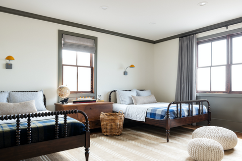 teen boys bedroom with spindle beds