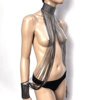 Fringe collar and cuffs, chocker, necklace with tassels to cuffs, silver chrome metallic and black fringes.