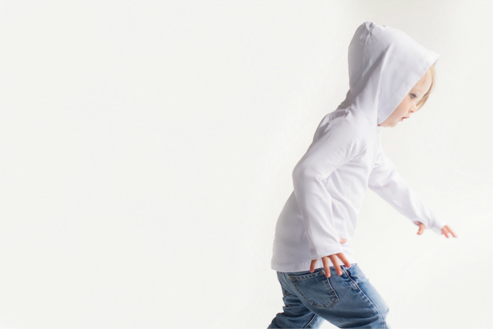 Young boy wearing a Baby Blanks white hoody with thumbholes
