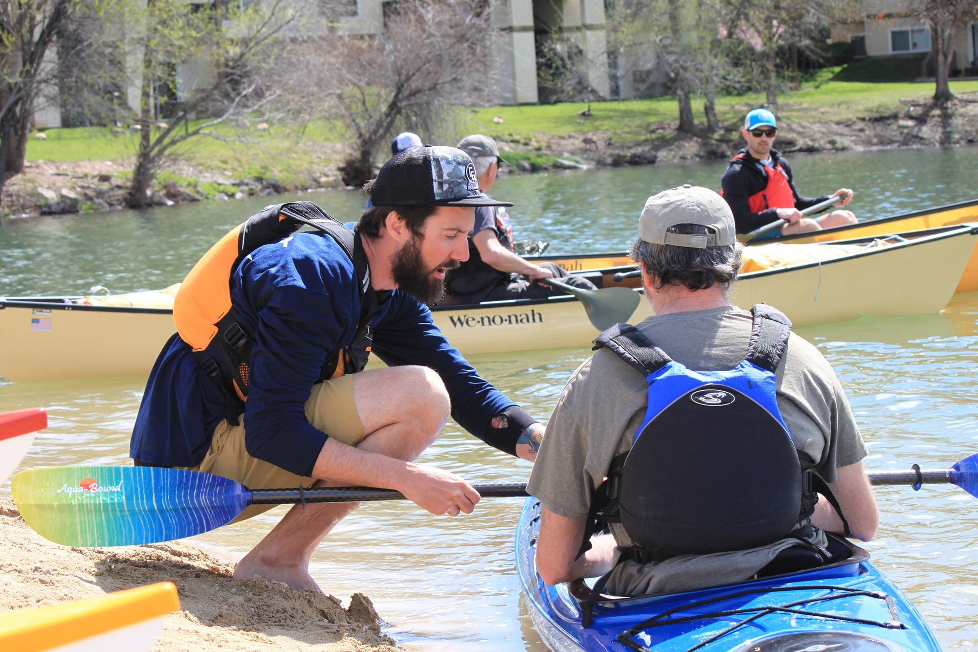 Nick Wittman helps F.I.T an Eddyline Customer to his kayak