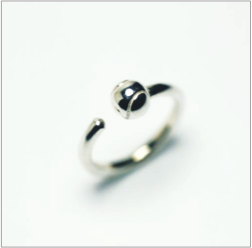 Tennis ball ring in sterling silver