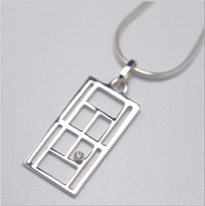 Large tennis court pendant in sterling silver with diamond