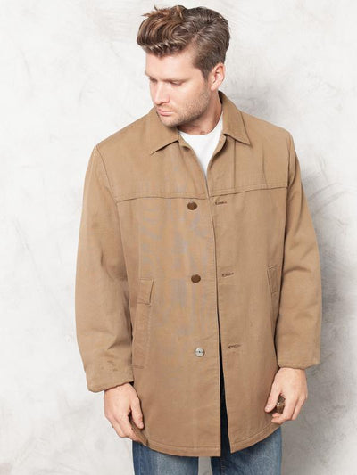 Model wearing classic 70's brown cotton jacket that looks amazing