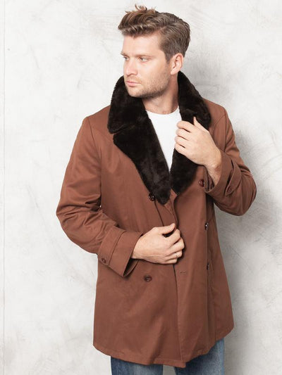 Model wearing amazing 70's faux sheepskin leather coat in brown color